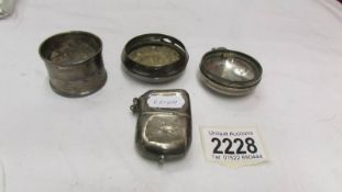 A silver napkin ring, 2 silver watch cases and an a/f silver vesta case.