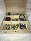 A box containing costume jewellery including old fob, earrings & lighters etc.