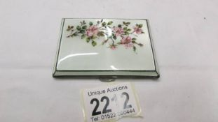 A silver and enamel cigarette case.
