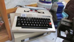 A Maritso 30 portable typewriter,
