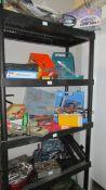 """Four shelves of workshop tools and sundries including a """"Bricky"""" and a Dustbuster."""