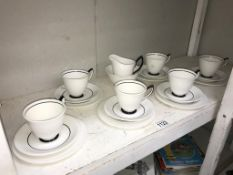 A Royal Albert white tea set with black lining