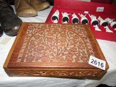 An oriental carved wood box.