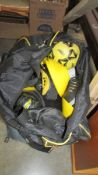 Two bags of football training equipment.