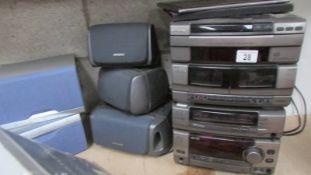An Aiwa music centre with speakers, tested and working,