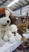 A large St. Bernard, a lion and a white bear.