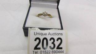 A 9ct gold ring set diamonds, size M, 2 grams.