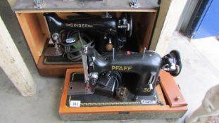 A Singer sewing machine and a Pfaff sewing machine.