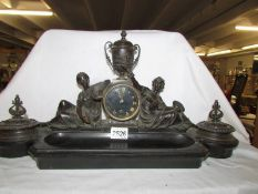A heavy bronze and slate clock/desk stand with 2 inkwells, (one hinge a/f) in working order.