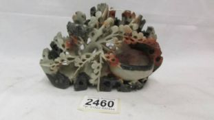 An oriental soapstone carving.