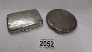 A silver cigarette case and a silver powder compact.