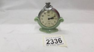 A 1930's Smith's pocket watch stand complete with Smith's pocket watch.