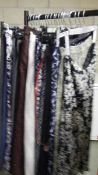 A good lot of ladies skirts / trousers including floral, beige and polka dot designs.