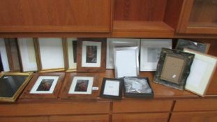A quantity of mainly new photo frames.