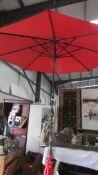 A large garden parasol in good condition.
