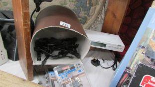 An under shelf radio, a Sony FM radio, packets of padlocks, hardware, lamps etc.