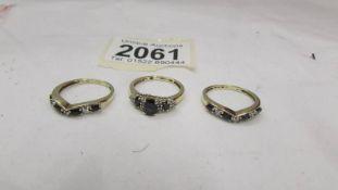 Three gold rings set various stones. 5.2 grams.