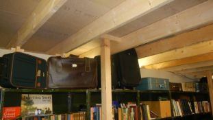 A large quantity of assorted suitcases. (Collect only).