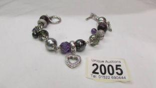 A Gento all silver heart bracelet.