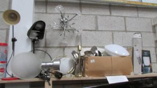 A good lot of new and used lighting including vintage angle poise lamp and new ceiling fan in box.
