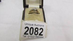 A 9ct gold diamond ring, size M half. (2.