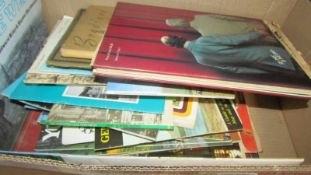 A box of books etc.