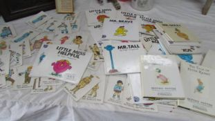 A quantity of Mr Men books and a set of old snap cards.