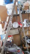 A wooden step ladder,
