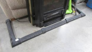A cast iron fire curb.