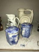A pair of windmill Palissy ware lidded pots,