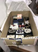 A large lot of boxed costume jewellery,