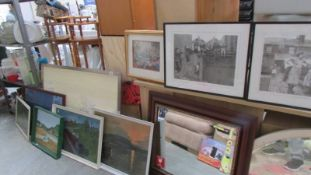 A mixed lot of paintings and prints.