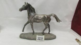 A hall marked silver (resin interior) horse (repair to tail).
