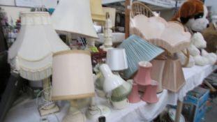 A large lot of table lamps, shades etc.