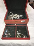 A jewellery box containing pearl necklaces,
