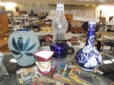 19th century Florentine cameo blue glass vase and a blue glass finger lamp,