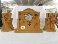 A 1930's ceramic clock garniture.