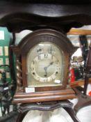 An oak cased bracket clock with barley twist columns, in working order.