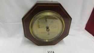 A good quality hexagonal mahogany brass faced barometer with string inlay by Curry & Baxton, London.
