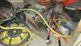 A huge lot of garden tools, a ready to fit BMWX5 sport tow bar and a bucket of chain.