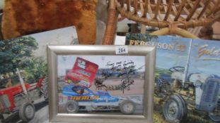 Two retro metal Massey Ferguson tractor signs, and a stock car a/f racing photograph, signed.