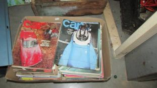 A box of car periodicals.