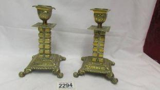 A pair of decorative brass candlesticks.