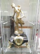 A 19th century French marble and gilt mantel clock surmounted female figure.