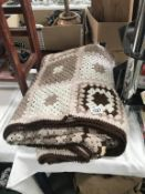 A large crocheted throw