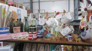 A mixed lot including mugs, napkin rings etc.