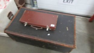 An old cabin trunk and a small suitcase. (Collect only).