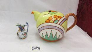A vintage teapot and a miniature jug.