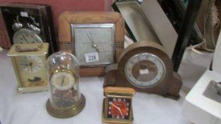 Five clocks and a barometer.