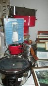 Two slow cookers, A Kenwood blender, stainless steel pans etc.